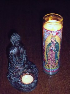 Prayer candles from Buddist and Catholic traditions