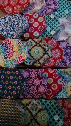Reversible, tri-fold flannel pads. Enough for 8 pads to go into 24 kits.