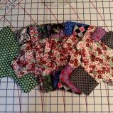 Reversible tri-fold flannel pad and shields with PUL, pockets and wings