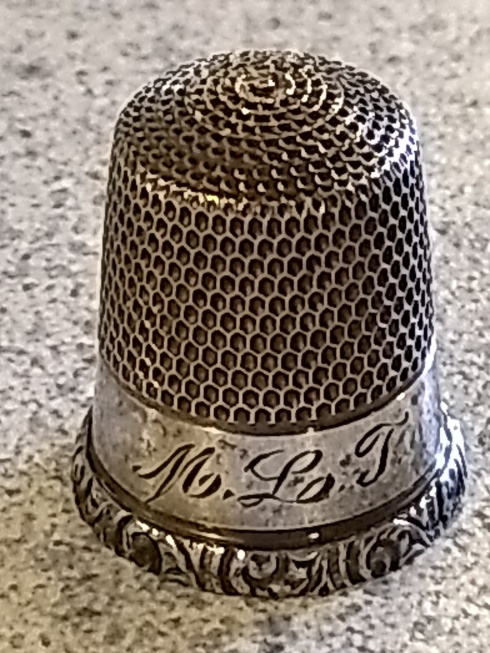 Mom's silver thimble